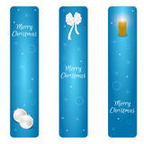 Christmas set of three vertical blue banner with white Christmas balls, white bow and a burning candle. Suitable for web design an Stock Photo