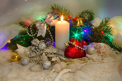 Christmas set, toys and a candle Royalty Free Stock Image