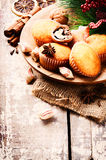 Christmas setting with cupcakes and winter spices Stock Image