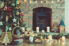 Christmas setting, decorated fireplace, fur tree Stock Photography