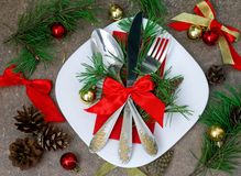 Christmas setting with festive decorations. On a dark background with a copy of the table space Royalty Free Stock Photography