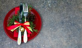 Christmas setting with festive decorations. On a dark background with a copy of the table space Royalty Free Stock Images