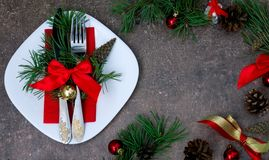 Christmas setting with festive decorations. On a dark background with a copy of the table space Stock Images
