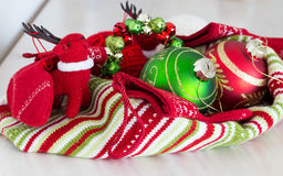 Christmas setting in green red and white with red deer toy Royalty Free Stock Photography