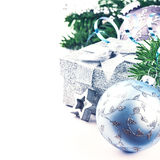 Christmas setting with present and festive ornaments Stock Image