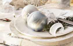 Christmas setting with silver balls and ribbon, fir tree branche Stock Image
