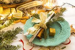 Christmas setting with silver balls and ribbon, fir tree branche Royalty Free Stock Image
