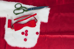 Christmas sewing still life includes fabric and. Craft supplies for creating festive decorations and ornaments Royalty Free Stock Images