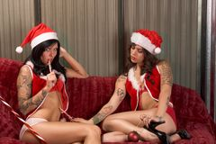 Christmas sexual games of young lesbian lovers Royalty Free Stock Images
