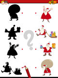 Christmas shadow game. Cartoon Illustration of Educational Shadow Game for Children with Santa Claus Characters Royalty Free Stock Photo
