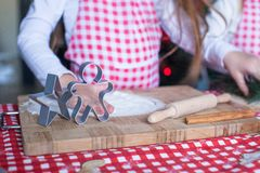 Christmas shapes pastry cutters on wooden board Royalty Free Stock Photography