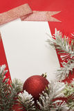 Christmas sheet of paper and baubles royalty free stock photo