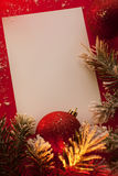 Christmas sheet of paper and baubles stock images