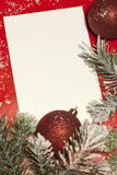 Christmas sheet of paper and baubles Stock Photography