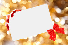 Christmas sheet of paper with bow and ribbons Stock Photo