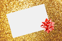 Christmas sheet of paper with bow and ribbons Royalty Free Stock Photography