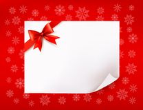 Christmas sheet of paper and red bow Stock Image