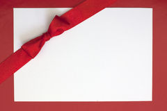 Christmas sheet of paper and red ribbon Stock Photo