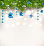 Christmas shimmering background with fir twigs and glass balls Stock Photos