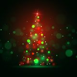 Christmas shining background with xmas tree lights Stock Photo