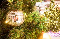 Christmas shiny ball hanging on pine tree. Christmas shiny ball decoration items hanging on pine tree with warm light Stock Photos
