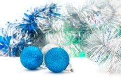 Christmas shiny blue balls. With silver garland stock photos