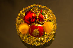 Christmas shiny colored decorations in a glass bowl Stock Image