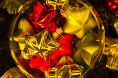 Christmas shiny colored decorations in a glass bowl Stock Photo