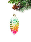 Christmas shiny colorful cone  on fir branches with snow decorat Royalty Free Stock Photography