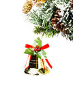 Christmas shiny golden bell  on fir branches with cones and snow Stock Photo