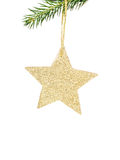 Christmas shiny golden star  on fir branches with decorations  I Stock Image