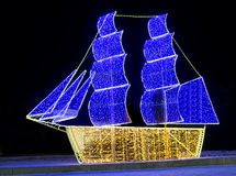 Christmas ship from multicolored lights Stock Photos