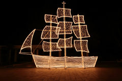 Christmas ship at night. In the Greek tradition ( especially in the islands ) it is common to ornament a ship  instead of a tree for Christmas Royalty Free Stock Photo