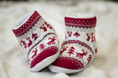 Christmas shoes. White red baby christmas shoes Stock Photography