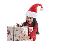 Christmas Shopper. A young girl shopping for xmas presents. Childhood, Christmas Royalty Free Stock Image