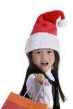 Christmas Shopper. A young girl shopping for xmas presents. Childhood, Christmas Stock Photos