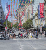 Christmas Shoppers in Busy Bourke Street Mall, Melbourne, Australia. Crowds of Christmas shoppers walk along the busy Bourke Street Mall and cross at the Royalty Free Stock Photo