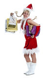 Christmas shopping. Cute girl in christmas outfit with lots of shopping bags Royalty Free Stock Images