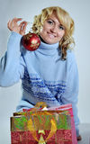 Christmas shopping. Blond lady with shopping christmas bag and gift inside Royalty Free Stock Photo