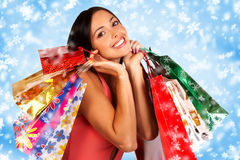 Christmas shopping. Smiling Santa woman . Over blue background royalty free stock image