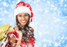 Christmas shopping. Smiling Santa woman . Over blue background royalty free stock photos