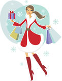 Christmas shopping. Beautiful Christmas girl holding shopping bags Stock Photos