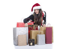 Christmas shopping. A beautiful woman doing christmas  shopping Royalty Free Stock Photos
