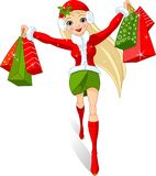 Christmas  shopping. Illustration of a girl with shopping bags Royalty Free Stock Image