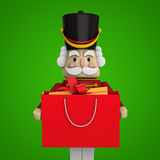 Christmas Shopping. Bag with Nutcracker. Clipping path included for easy selection Stock Photos
