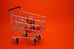 Christmas Shopping. Christmas ornaments in a shopping trolley cart stock photo