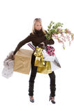 Christmas shopping. Teenage girl loaded with various bags doing christmas shopping on white background Royalty Free Stock Images
