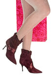 Christmas shopping. Woman's leg and high heel shoes Royalty Free Stock Photography