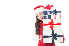 Christmas shopping asian woman holding many Christmas gifts Royalty Free Stock Photography