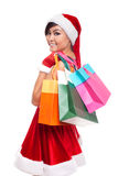 Christmas shopping asian woman thinking wearing santa hat and ho Royalty Free Stock Photos